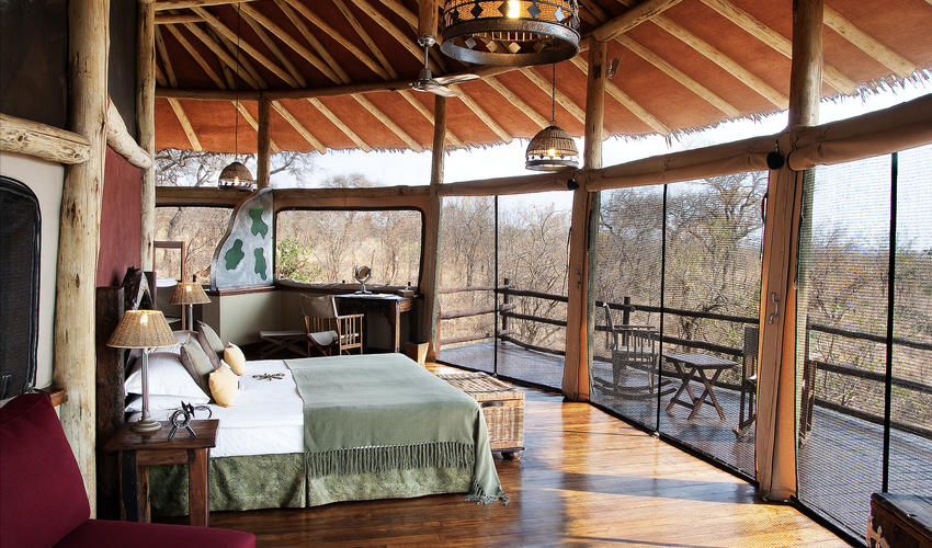Open fronted rooms provide views over the tree tops