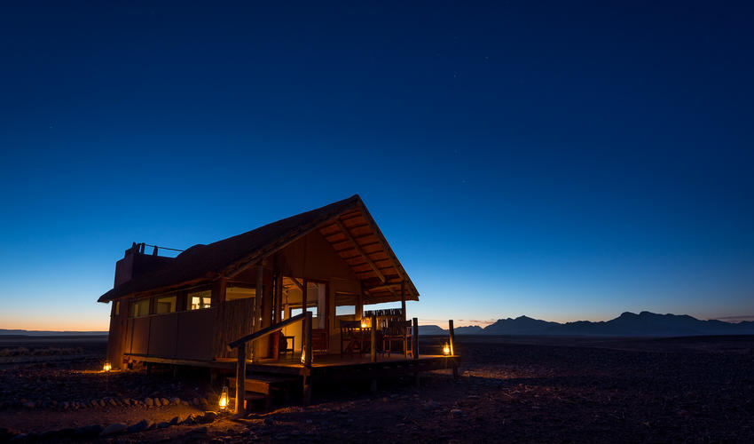 Guest tent and clear desert sky