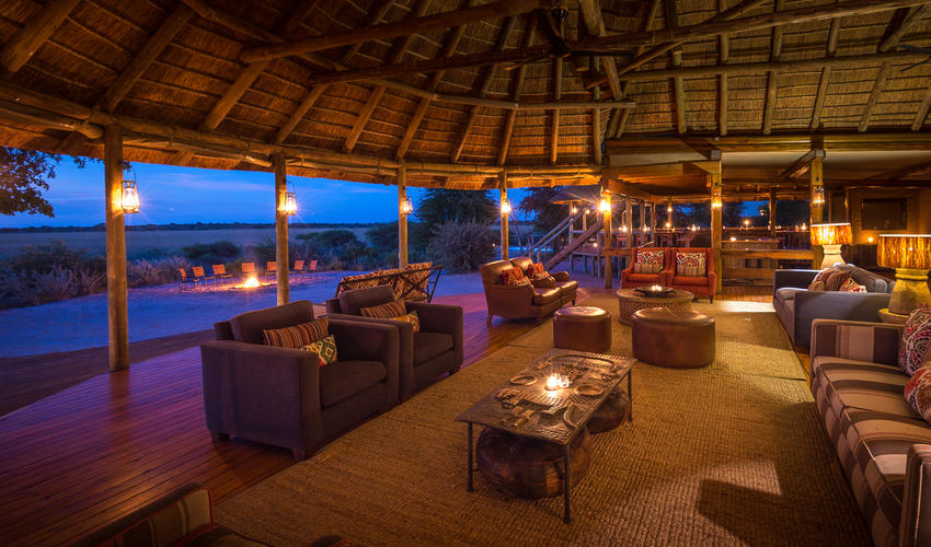 The thatch-covered lounge and open campfire