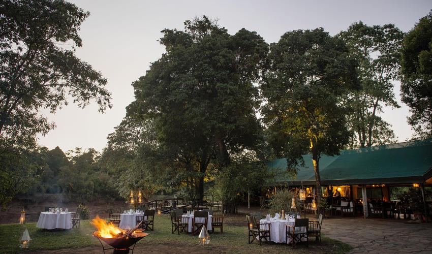 Dinner round camp fire