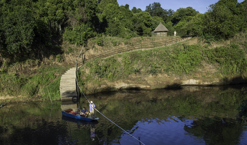 Cross the Mara River by boat to arrive at Little Governors' Camp