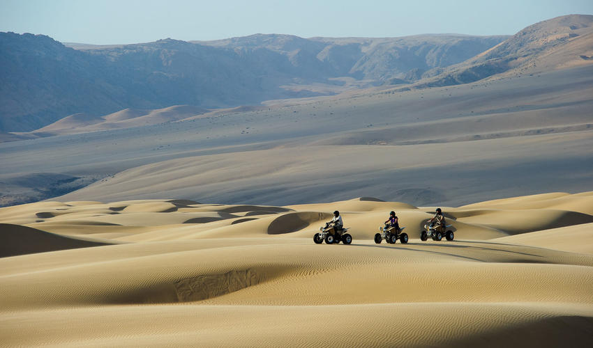 Explore the dunes by quad bike with an experienced guide