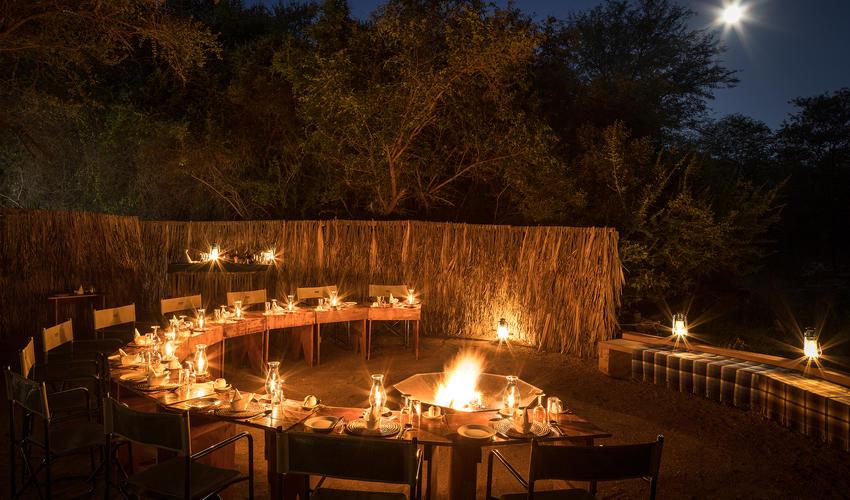 Dine under the stars around the crackling fire