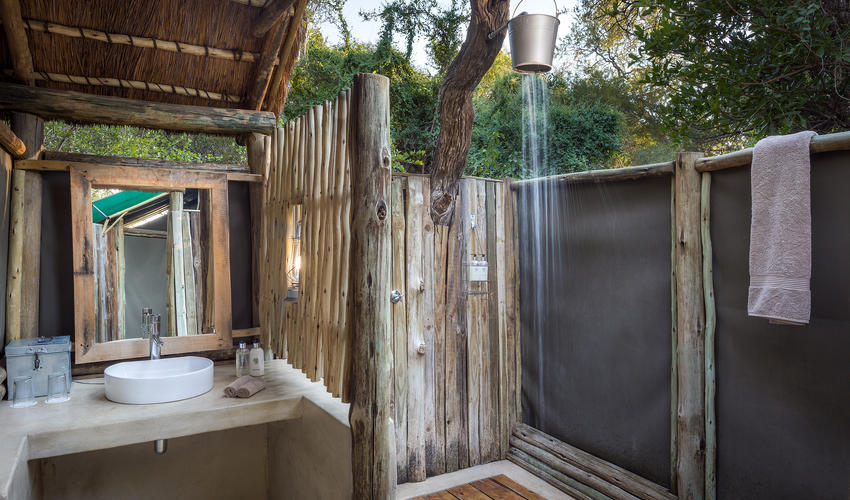 Outside showers (looks like a bucket shower, but actually a proper shower)