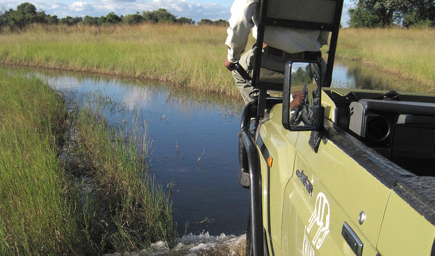 Water crossing - tracker and guide on all game drives