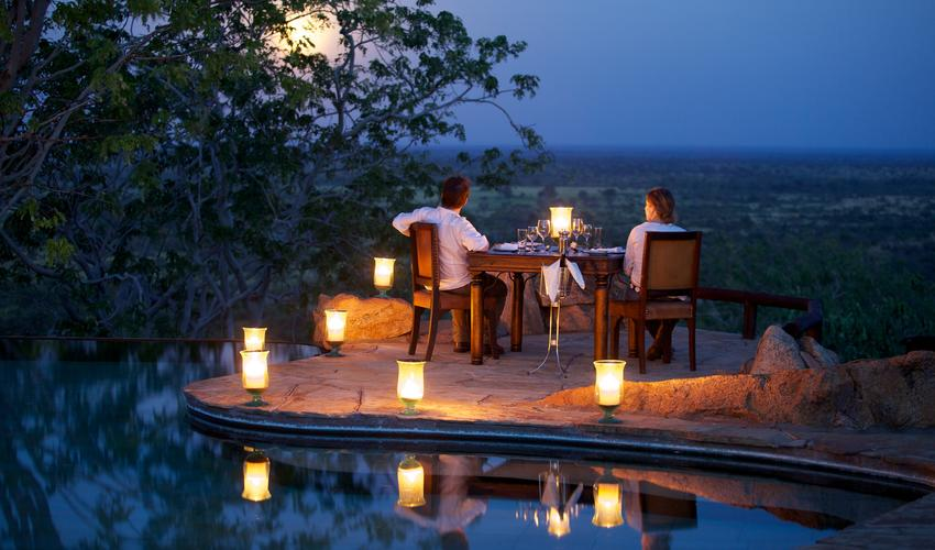 Romantic moon-lit dinner by the infinity pool