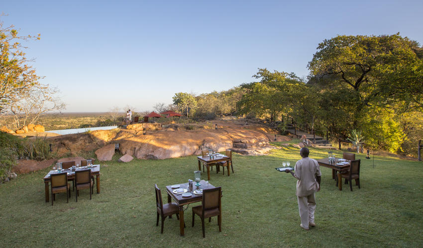 Dining out on the lawns, with views over the infinity pool to Meru plains beyond