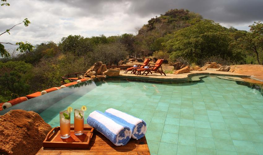 The inviting infinity pool, created using the natural features of rocks of the kopje