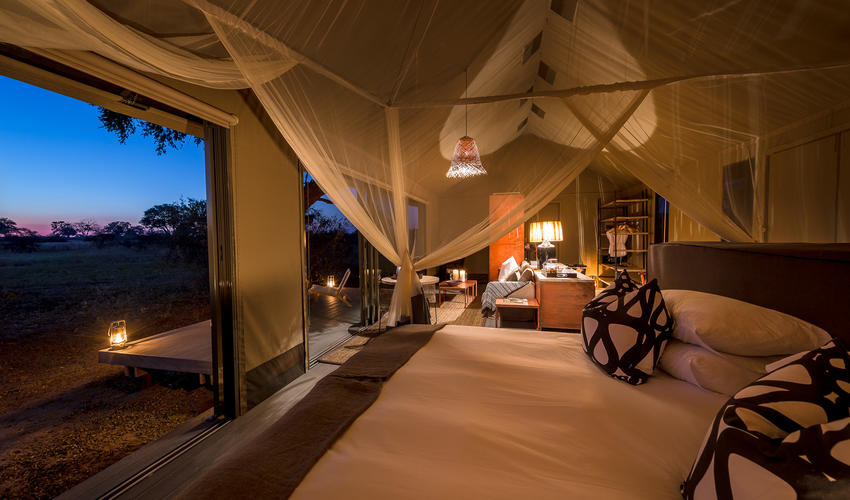 Tent bedroom with evening views