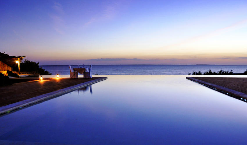 Picturesque infinity pool at dusk