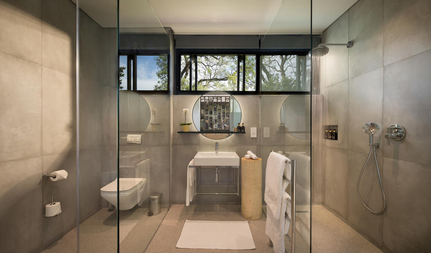 Contemporary bathrooms within our Luxury Rooms featuring large walk in showers