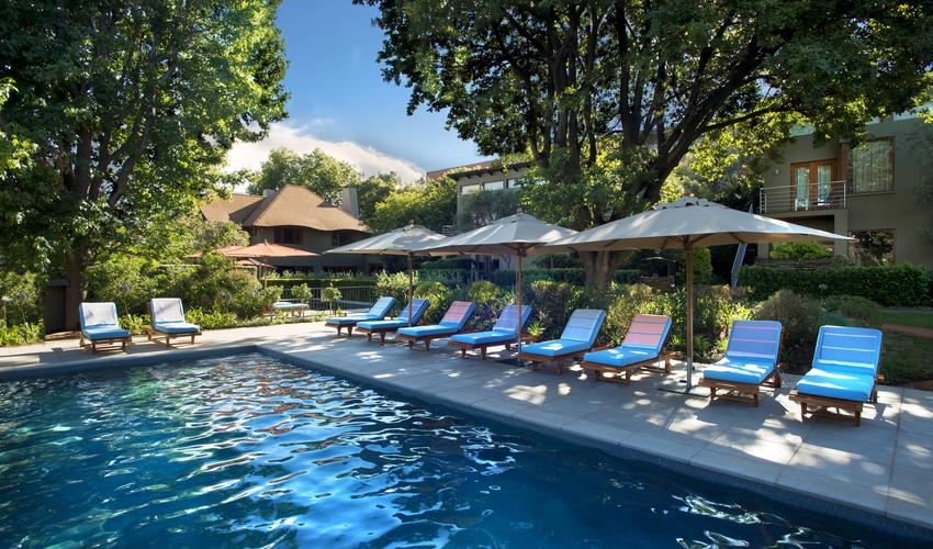 Larger lap pool with sun loungers and umbrellas