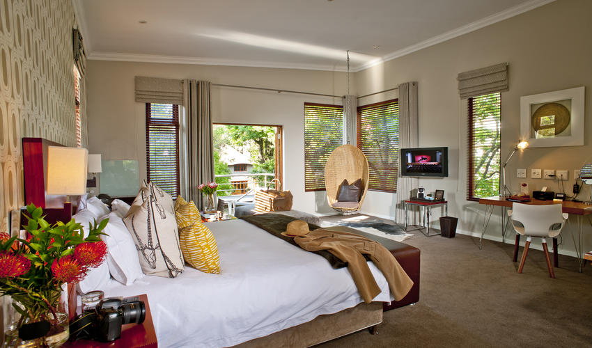 The suites are the hotel's most spacious rooms and are located in a quiet part of the lush gardens. They feature over-size bathrooms and an open-plan living space. A hanging pod chair gives views over their private patio or garden.