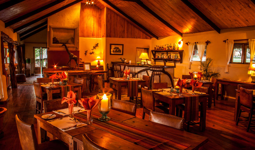 Cozy main lounge and dining area with log fires