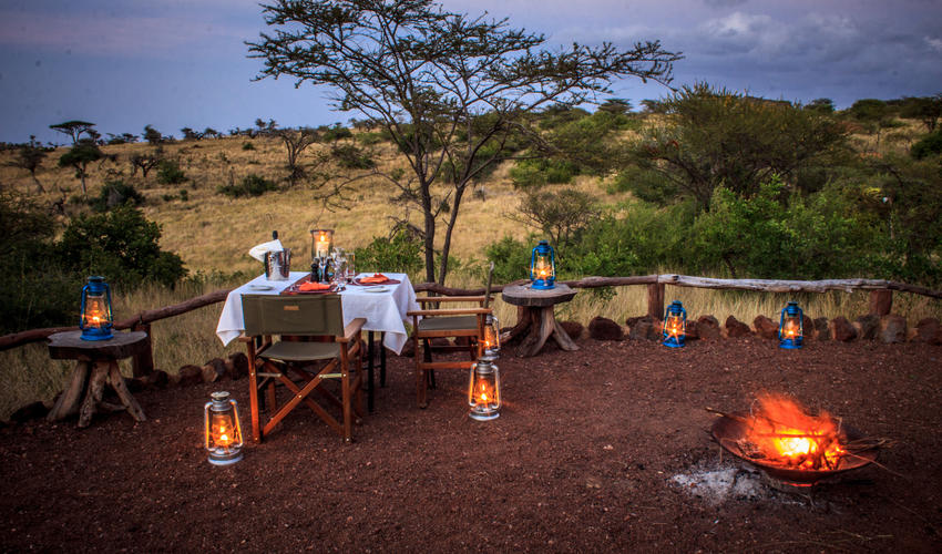 Sundowners by the camp fireplace