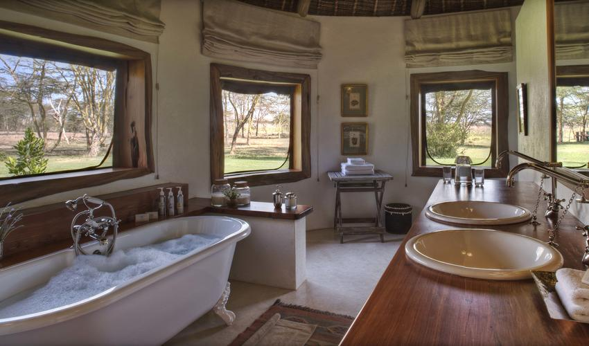 Each bedroom has an ensuite bathroom, with double sink inlaid into beautiful wooden tops, roll top free-standing baths and high pressure hot showers. Topped off with an unbeatable view, these might well be the best bathrooms in the world!