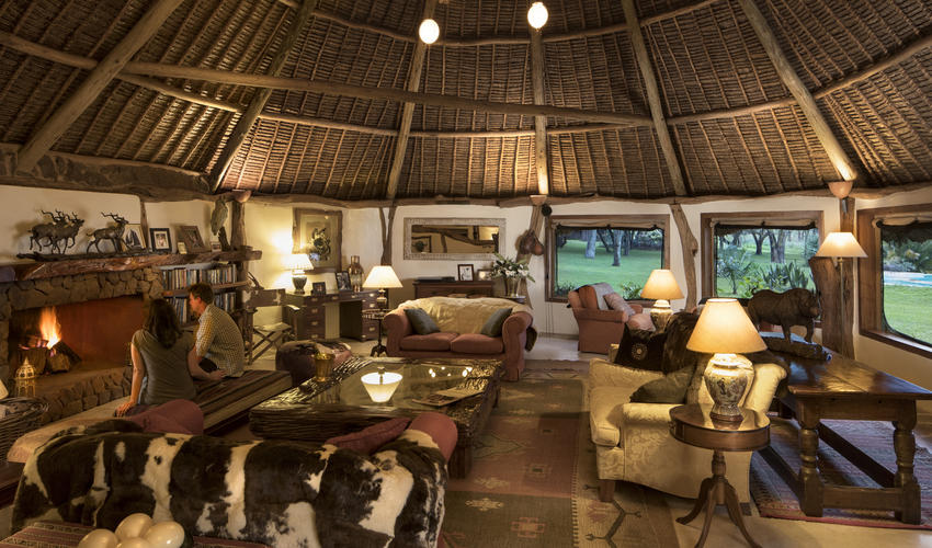 Family heirlooms, a library, large fireplace and African artifacts