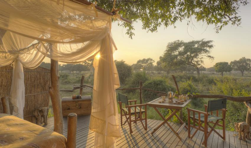 Totally open at the front, looking onto a waterhole and acacia plain. Two ensuite bedrooms with living & dining area between, built around three African Ebony trees.