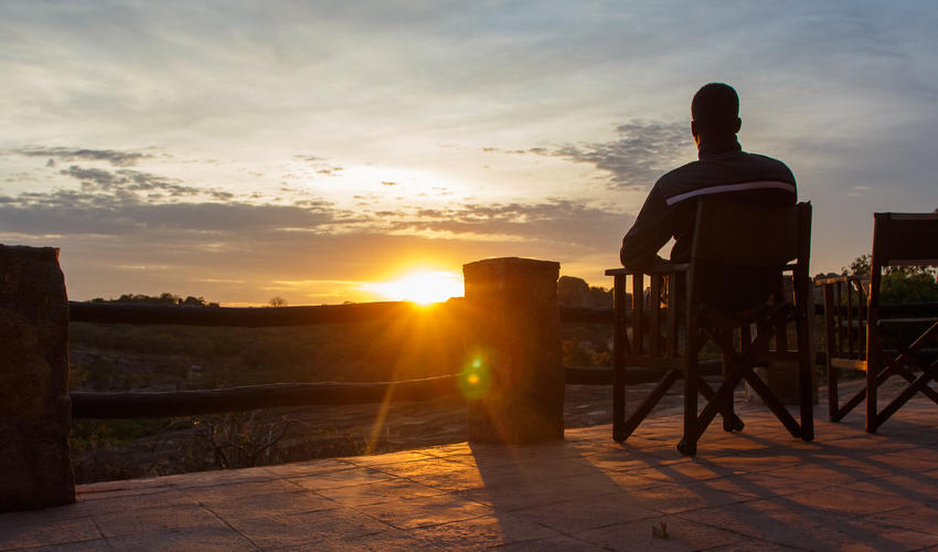 Every evening guests can choose their drink of choice and take it outside to watch the African sun set over the Matobo Hills