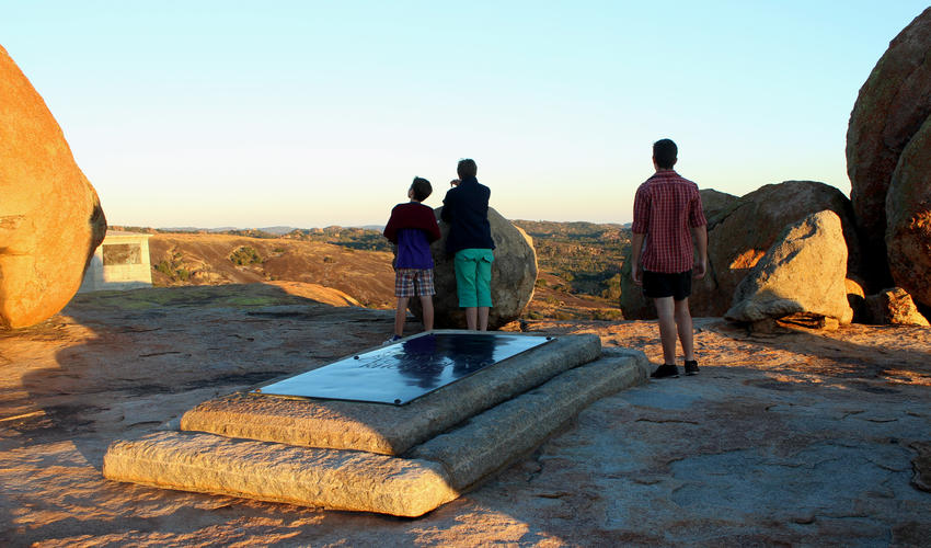 Guests walk up to the top of Malindidzimu kopje to see the various graves, including where Rhodes is buried.