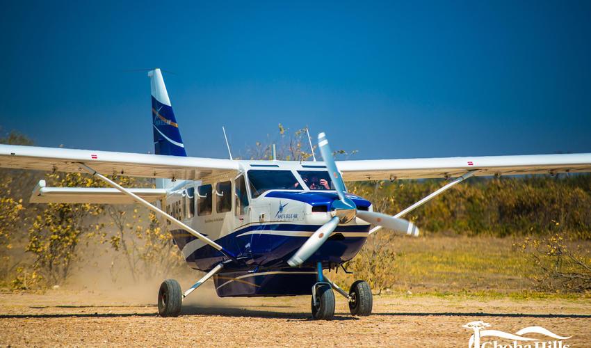 Light Aircraft landing at airstrip