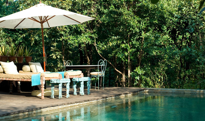 Guests can cool off in the sparkling swimming pool which contours along the nullah