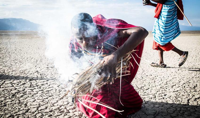 A Maasai creating fire