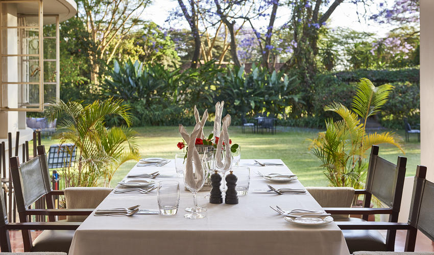 Dining on the veranda with views over the gardens