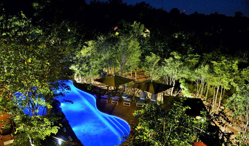 Aerial view of Victoria Falls Safari Club pool at night