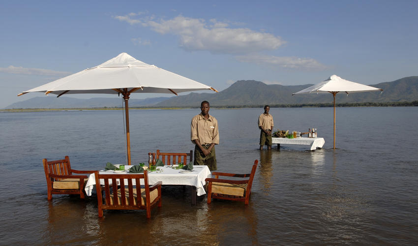 Dine with your toes in the Zambezi River