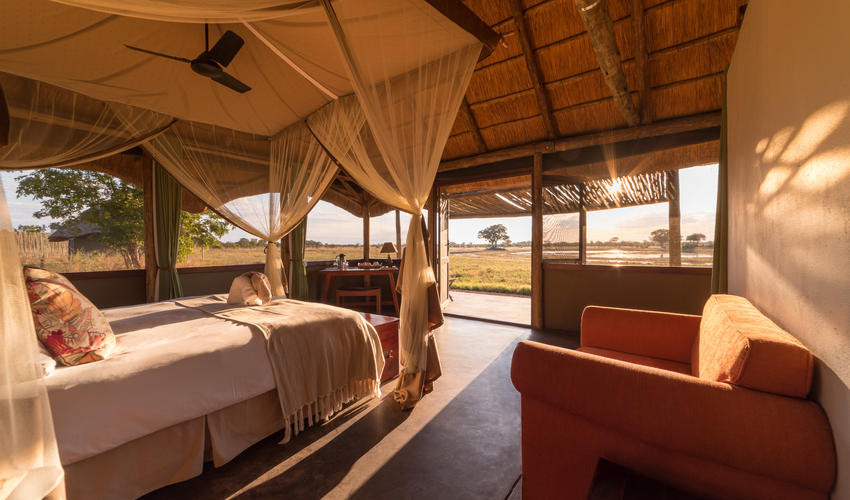 The rooms are spacious and offer views across the waterhole in front of camp