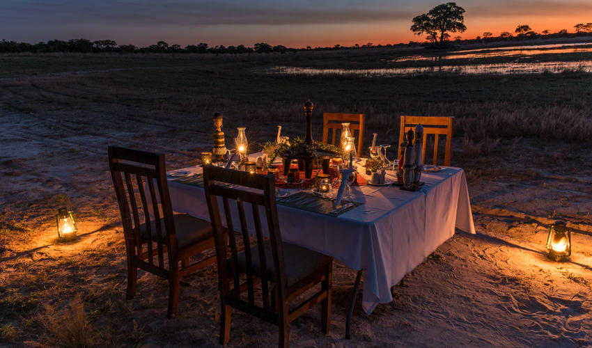 Enjoy bush dinner as the sun sets over Hwange