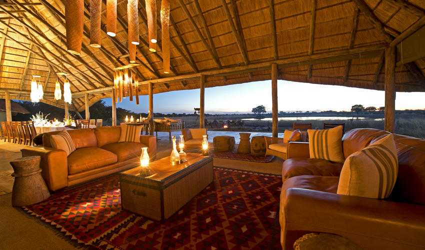 Camp Hwange main lounge area offers comfort and enchanting views over the waterhole