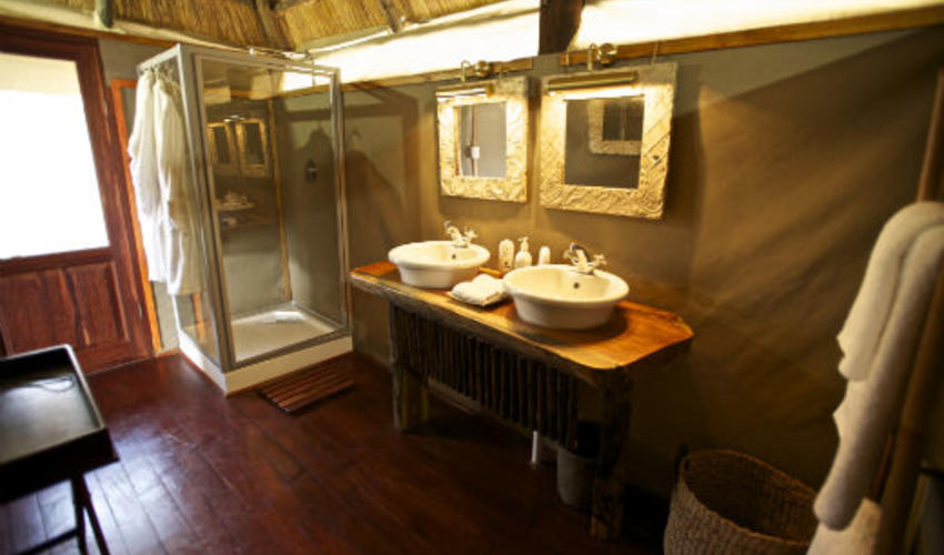 Each luxury tented room has a his and her bathroom as well as inside and outside showers - The Honeymoon suite is the only room with an outdoor bath.