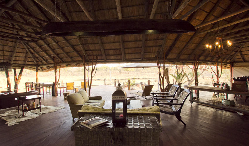 Main area consisting of lounge, outside deck with plunge pool and captains table