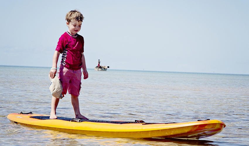 Little visitors learn the art of Stand Up Boarding