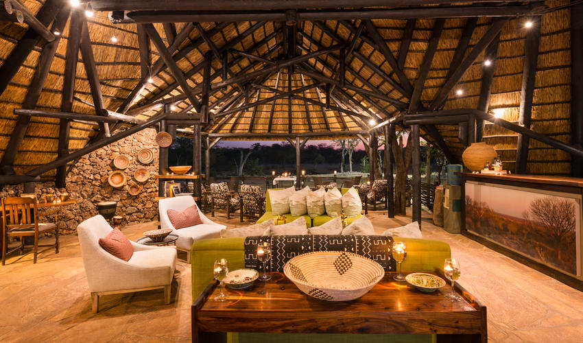 Guest lounge view of waterhole and bar