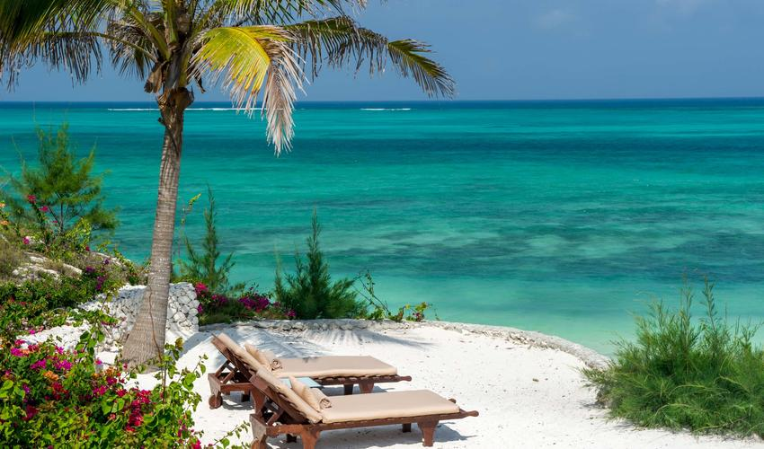 A view of the cool blue ocean from the lounges on the beach at Zawadi Resort and Spa, Zanzibar.