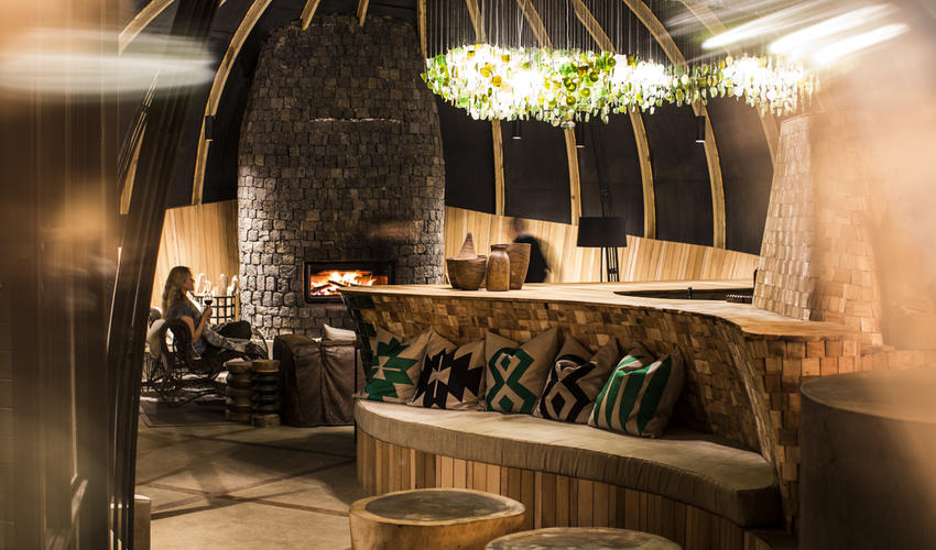 Relax around the welcome fire in Bisate's lounge area