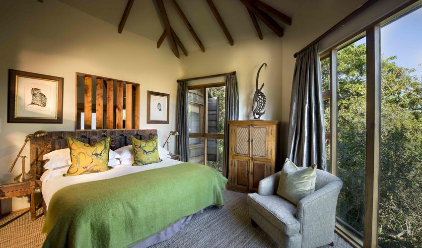 A Tsala Suite bedroom with forest views