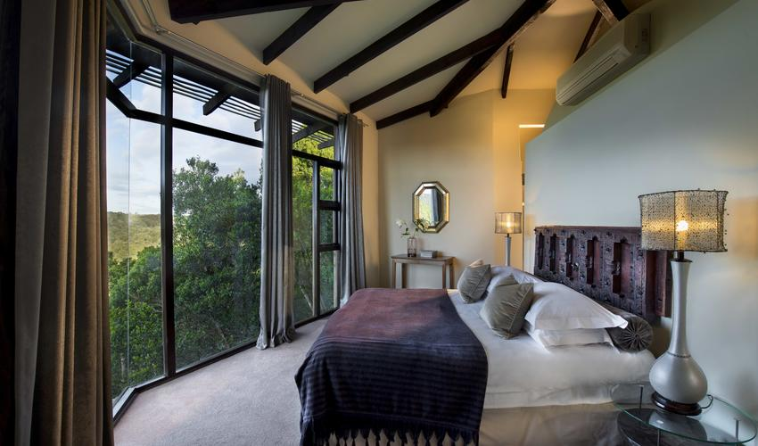 A Tsala Villa bedroom with forest views