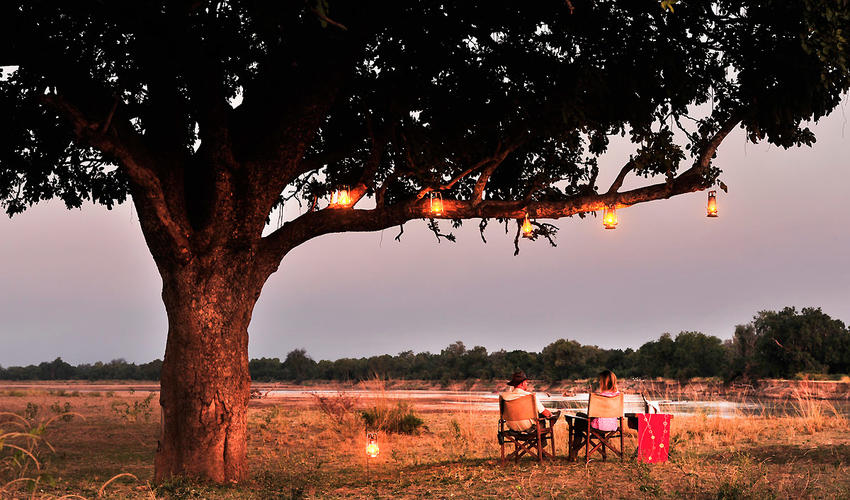 Enjoying a sundowner by the Luangwa River
