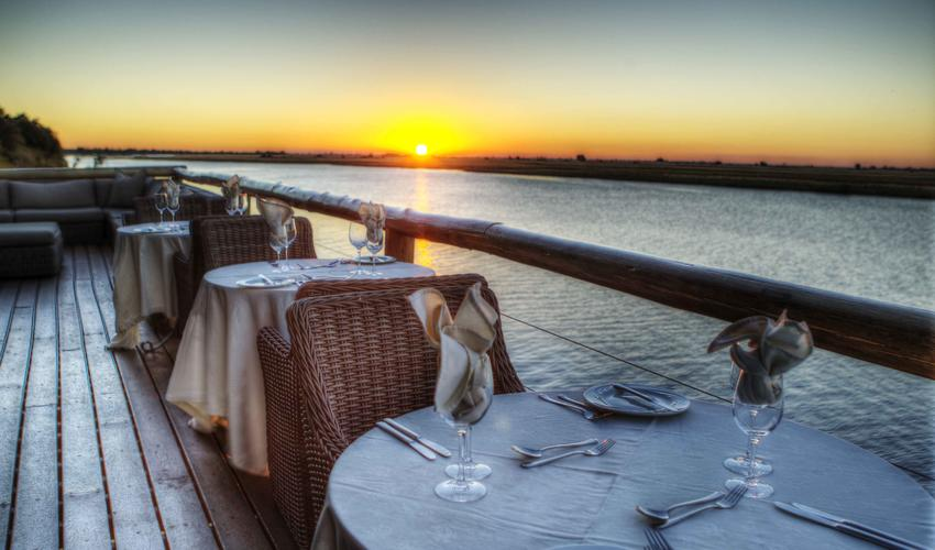 Private dining on the Chobe deck with views across the Chobe River
