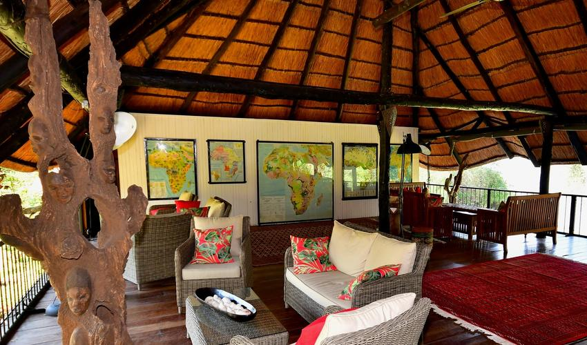 Comfortable lounging furniture, a spectacular selection of Afrian maps, and a wonderful view of the Zambezi and game park