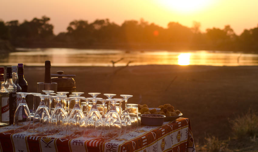 Nothing better than watching an African sunset with drink in hand