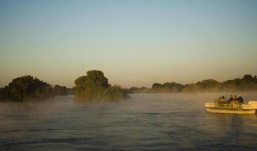 Explore the Upper Zambezi and surrounding Islands on an early morning Sunrise Boat Cruise