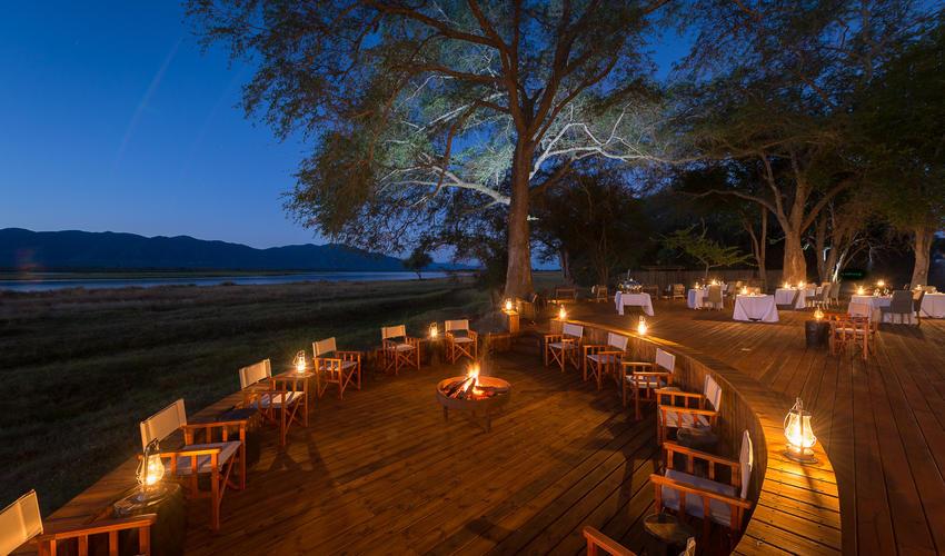 Enjoy an aperitif on the fire deck before dinner