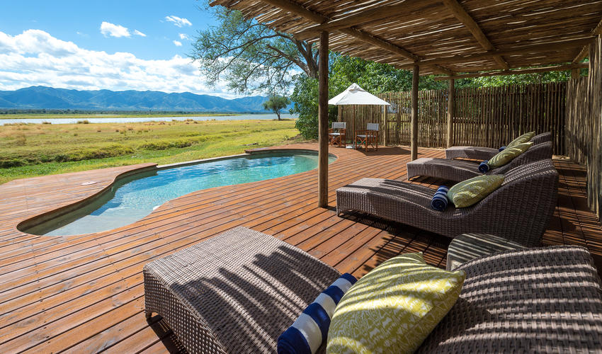 The pool area has sweeping views of the Zambian escarpment over the river