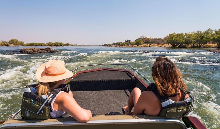 Enjoy sightseeing along the Zambezi River from the boat