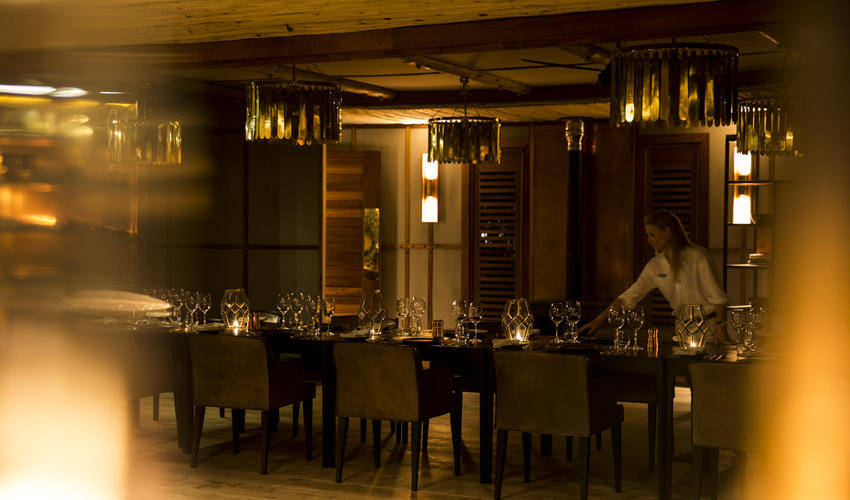 Little Mombo's main area comprises a dining room, kitchen and lounge